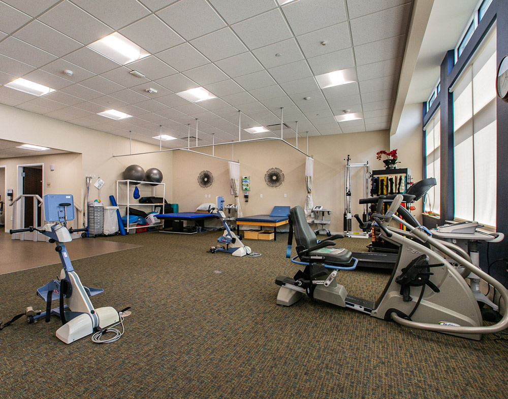 Hawkeye Care Center exercise room showing exercise equipment