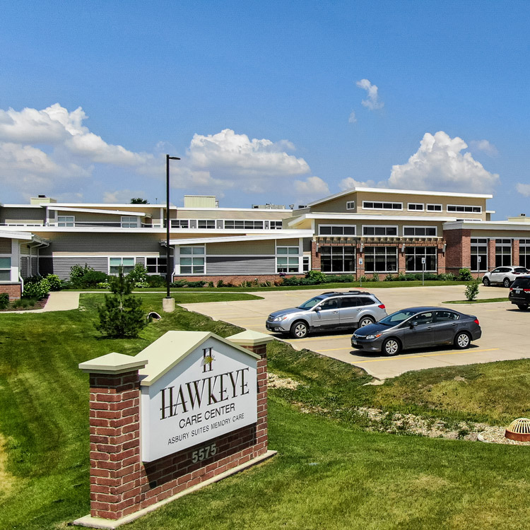 Outside of Hawkeye Care Center, with the welcome sign, parking lot, and front of the building