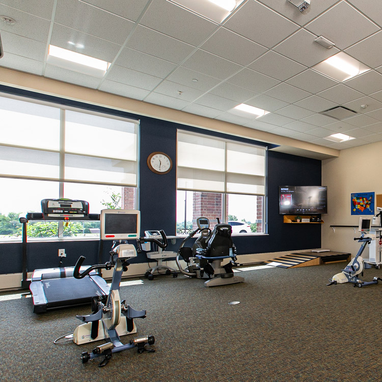 Hawkeye Care Center exercise room with a treadmill and other exercise equipment